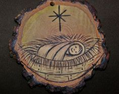 This rustic ornament made from a slice of a Hickory branch would be a perfect addition to your tree :-)  it is about 2 inches in diameter. I
