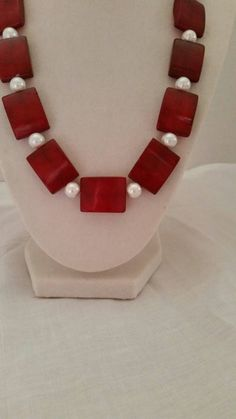 Check out this item in my Etsy shop https://www.etsy.com/listing/207400362/red-necklace-pearls-necklace-statement