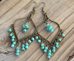I really need these...  Handmade Chandelier Earrings with Malachite. $13.99, via Etsy.