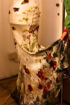 Hand painted silk dress - a collaboration between artist Josie Mitchell and designer Mari Hughes from Sow's Ear