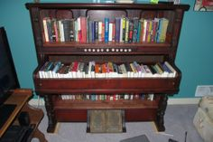 piano converted into a gipsy book shelves