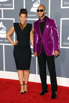 26cfed36 Alicia Keys hit the red carpet at this evening's Grammys in LA with her  husband Swizz Beatz. She paired a big-shouldered black gown with a large  statement