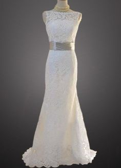 Vintage Lace V-Shape Open Back Fit and Flare Style Bridal Gown With Buttons, Satin Sash and Scalloped Edges. $279.00, via Etsy.
