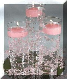 Diy wedding centerpieces pearls floating candles 27 new ideas Non Flower Centerpieces, Candle Wedding Centerpieces, Centerpiece Ideas, Candle Decorations, Sweet 16 Centerpieces, Graduation Centerpiece, Water Beads Centerpiece, Pink Party Decorations, Flowers Vase