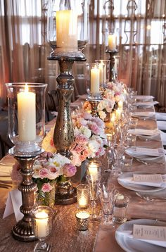 Elegant reception tables were decorated with dusty rose linens, sequin table runners, tall bronze candleholders, and petite floral arrangements of pink and white roses and peonies. #WeddingDecor Photography: KingenSmith. Read More: http://www.insideweddings.com/weddings/luxurious-summer-tent-wedding-on-lake-michigan-in-chicago-illinois/671/