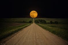 """""""Road To Nowhere- Supermoon"""" ---- Supermoon rises over this road to nowhere in eastern South Dakota.   Prints -  www.homegroenphotography.com facebook - www.facebook.com/HomeGroenPhotography Google+ - www.google.com/+AaronJGroen"""