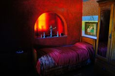 In an attempt to banish the darkness from her life, Helen Martins transformed her house into a kaleidoscope of rich blues, reds and greens, among other vibrant colours. She covered her walls with crushed glass and every window is tinted. The result is the enigmatic Owl House in Nieu-Bethesda. Photo: K van der Wielen Vibrant Colors, Colours, Art Corner, Crushed Glass, Owl House, Outsider Art, Heartland, Spy, Darkness