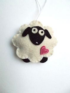 Felt sheep ornament - handmande felt ornaments - Christmas/Housewarming/Easter home decor - Baby shower - eco friendly by grabacoffee on Etsy https://www.etsy.com/listing/112763714/felt-sheep-ornament-handmande-felt