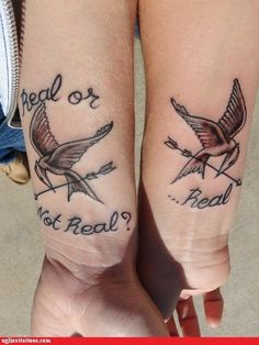 real or not real? hunger games tattoo. i think this is too far, but still a cute couple's tattoo. cpalm1
