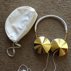 Frends Taylor Headphones - White/Gold The ultimate pair of headphones for a fashionista! Excellent condition! Barely used and kept in the enclosed headphone case when not in use. Sound quality is great (awesome bass), and the gold discs on each ear cup makes them super sleek and stylish. Can also be used as a hands-free mic when driving. Headphones fold into each other and can be stored in the pouch conveniently. 💖Price is firm - no trades. 💖 Frends Accessories Phone Cases
