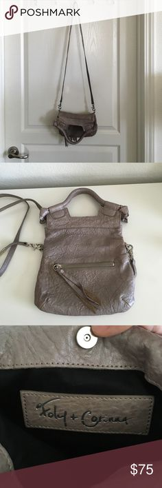 """Foley + Corinna Disco City Mini Crossbody Bag Textured leather bag accented with 2 exterior zip pockets. Has magnetic zip closure, double handles and shoulder strap. Color is a subtle metallic grey. There is a slight sheen to the leather. Dimensions are 9.5"""" x 9"""". Strap is 19"""" long. Includes a dust bag. Only carried a few times, so still in good condition. No trades or Paypal. Foley + Corinna Bags Crossbody Bags"""