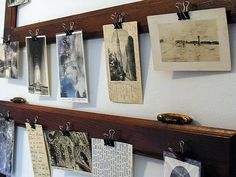 A DIY way of using postcards as decoration -- bulldog clip on old moldings