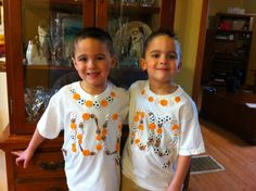 """I made the boys a 100 day shirt using 100 foam stickers and a hot glue gun.  It was very """"homemade"""" but they were so happy I made them and I know this is a kindergarten memory they will treasure!!"""