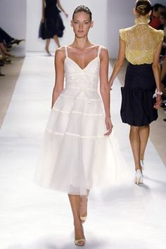 See the complete Monique Lhuillier Spring 2006 Ready-to-Wear collection.