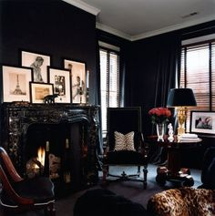 What an amazing den...loving the contrast between the black walls and cream photographs