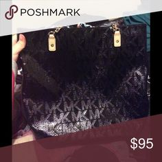 40bd08a888f7 Shop Women's Michael Kors Black size OS Bags at a discounted price at  Poshmark. Description: Black MK monogram tote bag in black.