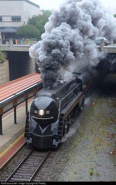 NS 957 with the N&W J class 611 passes southbound through the High Point Amtrak Station at speed.