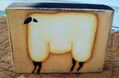 Primitive Handpainted Wood Sheep Sitter Block. $11,99, via Etsy.