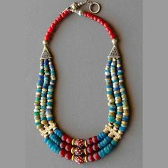 by Luda Hunter | Rare antique excavated glass beads from Djenne Mali feature in this wonderful and vibrant 3 strand necklace. Red African Fulani glass beads, venetian skunk trade beads, java glass beads and gold vermeil & silver complete the necklace.