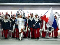 Bobsleigh racer Alexander Zubkov of the Russia Olympic team carries his country's flag during the Opening Ceremony of the Sochi 2014 Winter Olympics at Fisht Olympic Stadium. Sochi 2014 Opening Ceremony - Teams