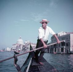 A gondolier on the Grand Canal in Venice, (Photo by Slim Aarons/Getty Images) Color Photography, Lifestyle Photography, Slim Aarons Prints, Star Of The Day, Vintage Classics, Grand Canal, Unique Image, Canvas Pictures, Image Collection