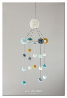 Your place to buy and sell all things handmade - Your place to buy and sell all things handmade Baby Pom Mobile in Aquas and Light Mustard by SwartwoodStudio Baby Crafts, Diy And Crafts, Arts And Crafts, Diy For Kids, Crafts For Kids, Pom Pom Baby, Baby Mobile, Felt Mobile, Pom Pom Crafts