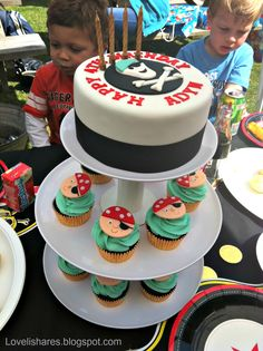 Cake and cupcakes for a pirate/skulls birthday party.  #Pirate #Skulls