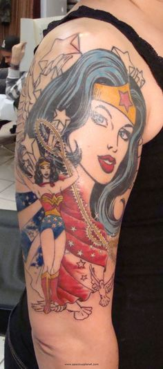 I've always been in love with Wonder Woman..Because I needed someone tall, beautiful and strong to look up too! I would seriously consider getting a tattoo like this...Just not on my arm <3