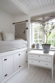 White bed nook w/ storage. Perfect for the tiniest of spaces.