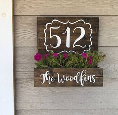 Address planter box. Handmade, painted in white and stained in dark walnut. It comes ready to hang with hanging wire attached to back and the planter has holes for proper drainage. It measures 14x14. This is the perfect addition to your front porch. Please leave house number and name or