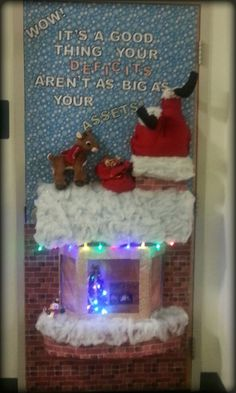 chaves county financeihc first place winner on door decorating contest features 3d santa stuck in the chimney with a lighted roof top and 3 d chimney with