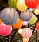 Luna Bazaar is an online store that sells paper lanterns and other party/wedding decorations. Some of the simple paper lanterns are as low as $1 for a colored 8-inch lantern, and up to $3.50 for a 20 inch lantern!