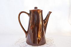 Hey, I found this really awesome Etsy listing at https://www.etsy.com/listing/206214879/brown-pottery-coffee-pot-vintage-coffee
