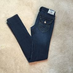"True Religion Julie Fit Skinny Leg Denim Jeans True Religion Julie Fit Skinny Leg Denim Jeans  Julie fit is a stem-flaunting skinny leg fit that lends itself to a leg-lengthening look when paired with your favorite high heel. Handcrafted attention to detail in our carries out a broken-in, well loved appearance while maintaining the integrity of the rich indigo color.  In PERFECT condition!!  Retail Price $180  Skinny fit Low rise  32"" inseam Zip fly 98% cotton, 2% spandex Size 25 True…"