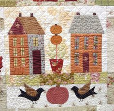 Autumn House quilted center block by Robin at Crafty Musings.  Design by Anne Sutton at Bunny Hill Designs