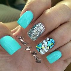 Blue and Silver Flower Nail Design.