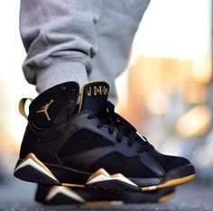 Black and gold Jordans