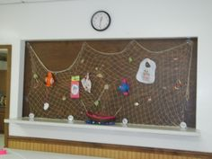 Fishing nets with all the baby stuff on it.  HOW CUTE!