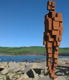Gormley sculpture at Clavell Tower now fallen down onto rocks