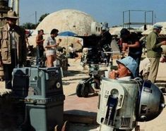 R2D2 (Kenny Baker) eating a sandwich on the set of Star Wars