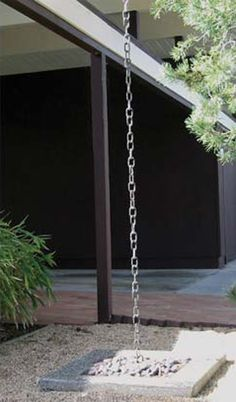 Rain chains. They are used in Japan as downspouts to direct rain from a gutter to the ground, where it either flows into a gravel or pebble bed or into some sort of catchment.