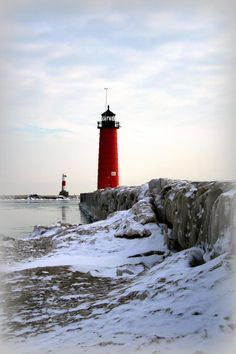 ✯ Peirhead Lighthouse on a very cold winter's morning.  The bright red, ironclad, historic lighthouse is located at the end of Simmons Island pier in Kenosha, Wisconsin