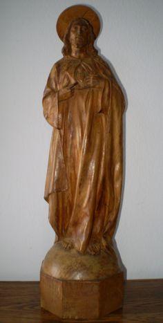 Magnifico Sagrado Corazón en madera tallada color natural. Redentor del mundo. Siglo XVIII-XIX. 49 x 13 cm.