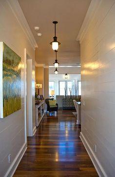 2008 HGTV DREAM HOUSE -FOYER -Horizontal paneling on the creamy walls visually extends the hallway.