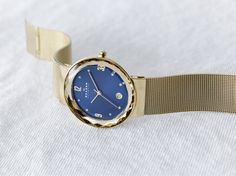 The blue dial of our Leonora watch reminds us of the deep blue waters surrounding the city of Skagen #watch #blue RiddlesJewelry.com