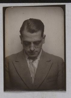 Luis Bunuel in a photo booth, the equivalent of Salvador Dali to film.