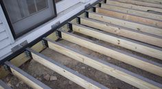 DIY deck building: How to waterproof wood framing using joist tape & c - Imus Industries, Inc. Deck Building Plans, Deck Plans, Cool Deck, Diy Deck, Deck Framing, How To Waterproof Wood, Laying Decking, Deck Construction, House Deck