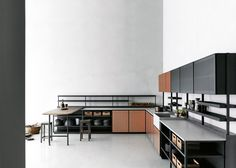 Launching in the UK for the first time in September, Urquiola's Salinas range is influenced by the kitchen in her grandfather's house and is based around matt-black metal frames.