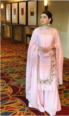 Nimrat Khaira Wiki/Biography: Nimratpal Kaur Khaira is a Punjabi singer, writer, and actress who came into the spotlight after singing. Punjabi Suits Party Wear, Party Wear Indian Dresses, Designer Party Wear Dresses, Dress Indian Style, Punjabi Suits Designer Boutique, Indian Designer Suits, Indian Suits, Sharara Designs, Kurti Designs Party Wear