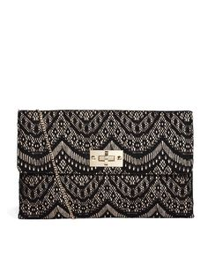Clutch bag by New Look    Made from a leather look fabric    Contrast lace design    Foldover design    Twist lock fastening    Inner zip pocket    Chain handleABOUT NEW LOOKOffering irresistible fashion and fast off the catwalk styles, New Look joins the ASOS round up of great British high street brands. Bringing forth their award-winning clothing collection of dresses, jeans and jersey basics alongside a punchy edit of accessories. Go glam with skater and bodycon dresses or keep casual…